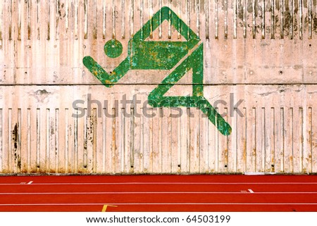 running track and a logo on the wall - stock photo
