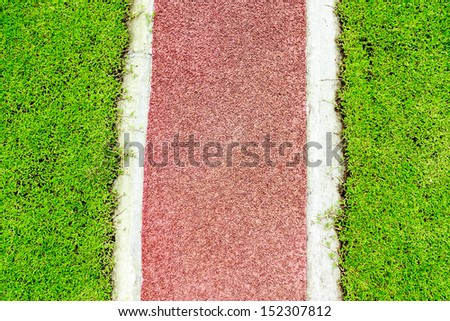 running track and green grass