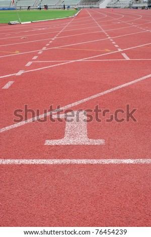 Running Track in number one at stadium - stock photo