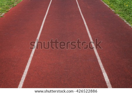 Running track in stadium, perspective, close up