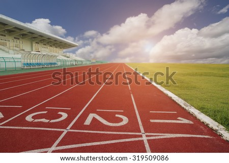 Running track inside the stadium in morning time - stock photo