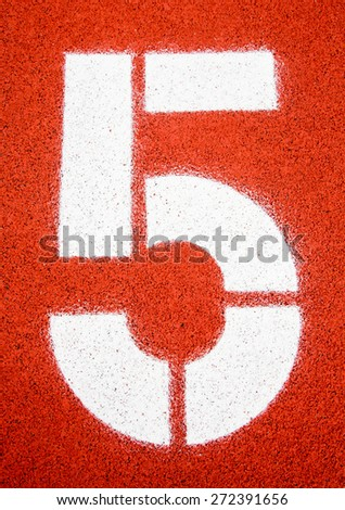 Running track, number 5 - stock photo