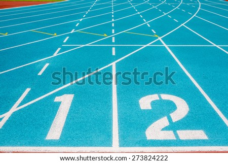 Running track numbers one two in stadium - stock photo