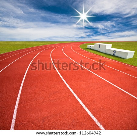 Running track over blue sky and clouds - stock photo
