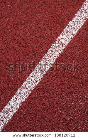 Running track rubber cover texture with line for background - stock photo