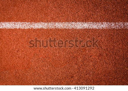 Running track texture background. top view - stock photo