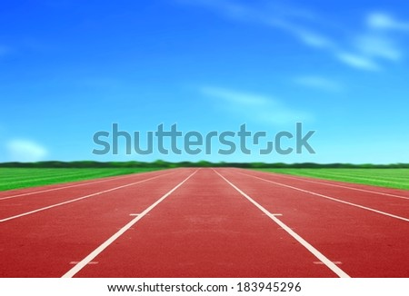 Running Track under Blue Sky - stock photo