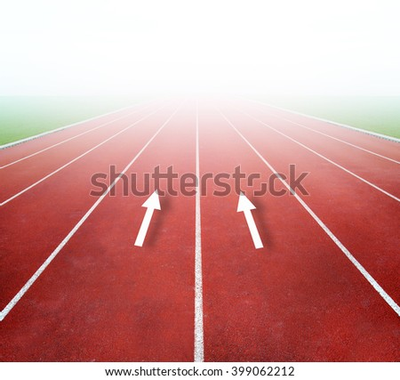 Running track with bright light in distance - stock photo