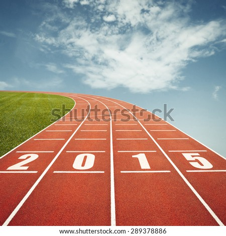 Running track with 2015 date floating in sky - stock photo