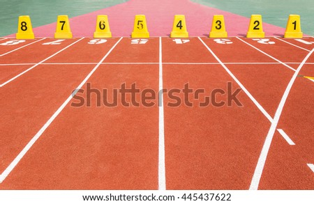 running track with  number in stadium  - stock photo
