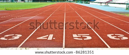 Running Track With Numbered Lanes - stock photo