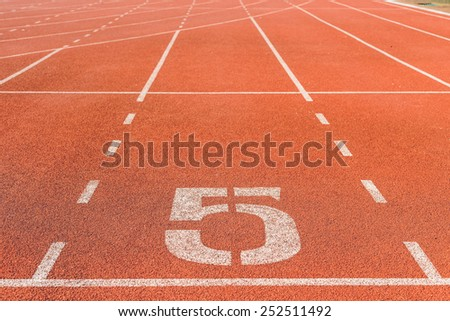 Running track with white number - stock photo