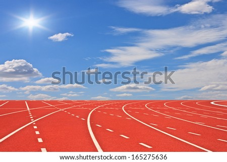 Running tracks and blue sky - stock photo