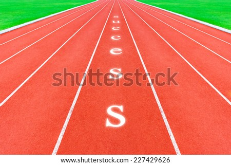 running tracks with success word - stock photo