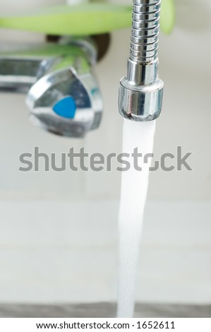 running water tap in kitchen - stock photo