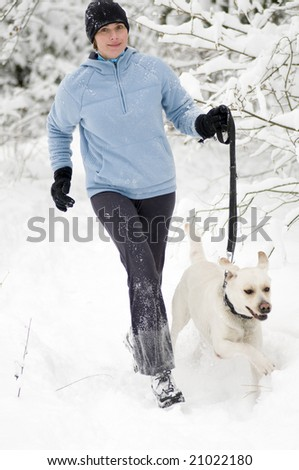 Running with dog at winter time - stock photo