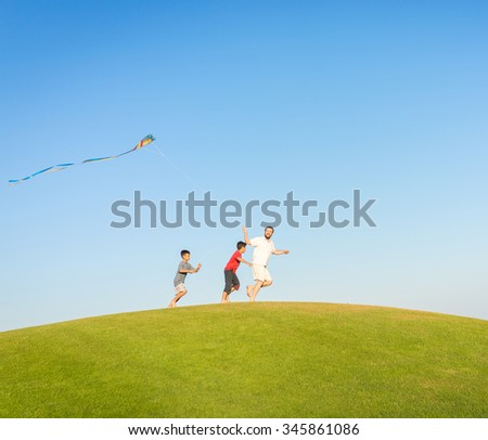 Running with kite on summer holiday vacation, perfect meadow and sky on seaside - stock photo