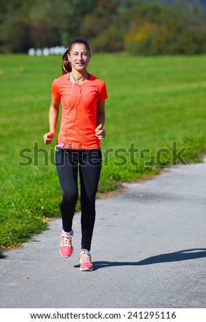 Running woman. Female runner jogging during outdoor workout