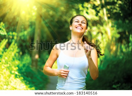 Running woman. Female Runner Jogging during Outdoor Workout in a Park. - stock photo