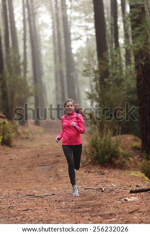 Running woman in forest woods training and exercising for trail run marathon endurance race. Fitness healthy lifestyle concept with female athlete trail runner. - stock photo