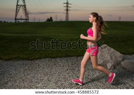 Running woman. Runner jogging in sunny nature.