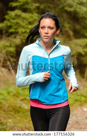 Running woman with headphones outdoor close-up - stock photo