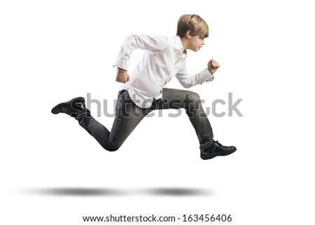 Running young boy isolated on white background - stock photo