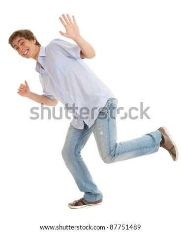 running young man  in bright shirt waving helo, white background