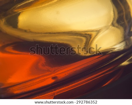 Runny honey - farm produced honey in thick glass pot. Closeup detail. - stock photo