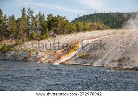 Runoff from Excelsior Geyser Crater in Yellowstone National Park, Wyoming. - stock photo