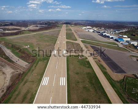 Runway approach at a small rural Ohio airport. - stock photo
