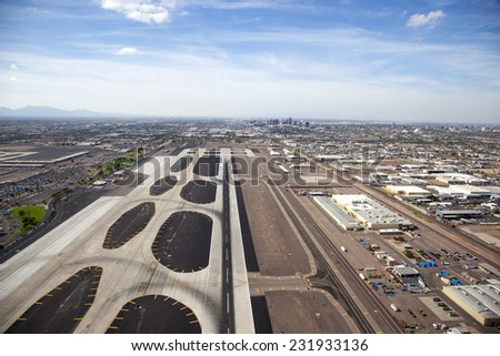 Runway at Sky Harbor airport with Phoenix, Arizona skyline - stock photo