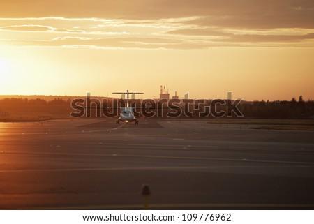Runway at sunset - back lit - stock photo