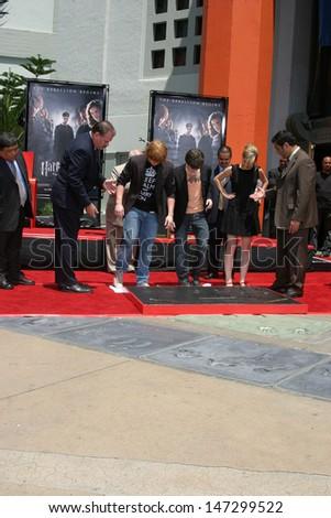 Rupert Grint, Daniel Radcliffe, and Emma Watson Harry Potter Handprint/Footprint/Wandprint Ceremony Grauman's Chinese Theater Los Angeles, CA July 9, 2007 - stock photo