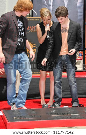 """Rupert Grint with Emma Watson and Daniel Radcliffe at the Hand, Foot and Wand Print Ceremony Honoring The Cast of """"Harry Potter"""". Grauman's Chinese Theater, Hollywood, CA. 07-09-07 - stock photo"""