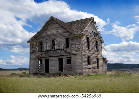 Rural Abandoned Homestead in a rural field in western America - stock photo