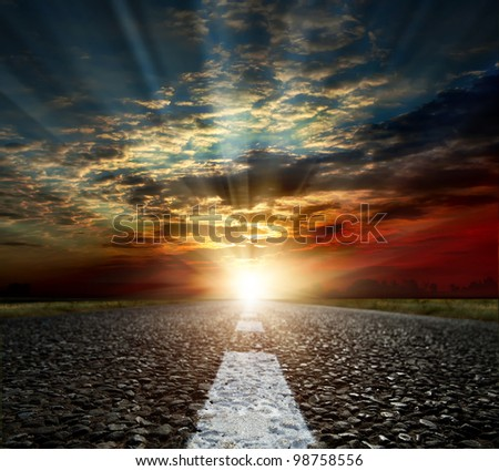 Rural asphalt road in sunset - stock photo