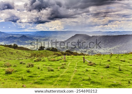 Rural australian agricultural property in barrington tops mountains - the gate in a grass for grazing cattle - stock photo