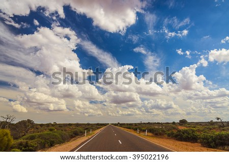 Rural Australian highway road through remote outback - stock photo