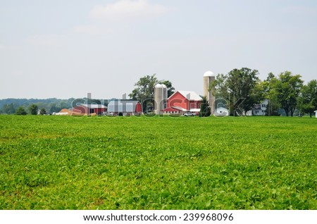 Rural Barn and surrounding countryside and farmland - stock photo