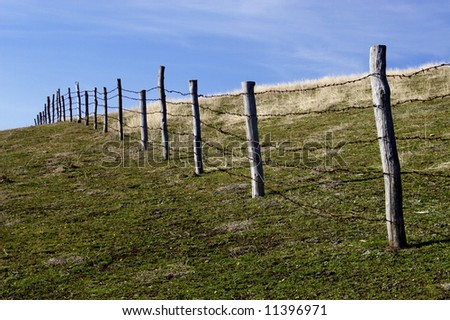 Rural fencing in harsh environment - stock photo