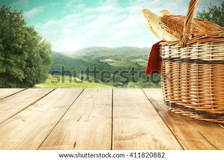 rural landscape and bread and basket and lunch time  - stock photo