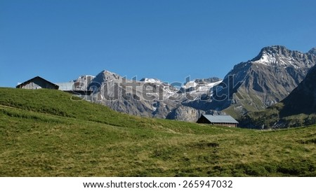 Rural landscape near Gstaad, view from the Wispile - stock photo