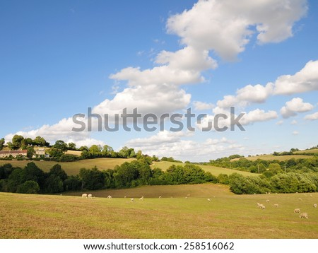Rural Landscape View of an Open Field and Blue Cloudy Sky in the Avon Valley near Bath in Somerset England - stock photo