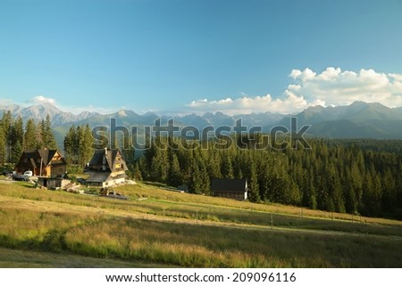 Rural landscape with a view of the Tatra Mountains in the distance, Poland. - stock photo