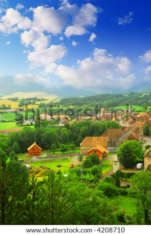 Rural landscape with hills and a small village in eastern France - stock photo