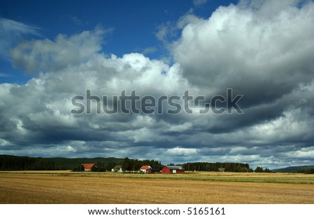 Rural landscape with sky and field - stock photo