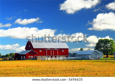 Rural lanscape with red barn in rural Ontario, Canada.