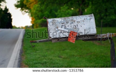 Rural Mailbox with Chipped Paint and Open Door - stock photo