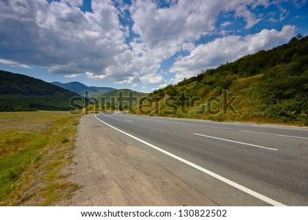 Rural mountain landscape with highway road.